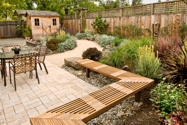 Paver patio with drought tolerant backyard landscaping
